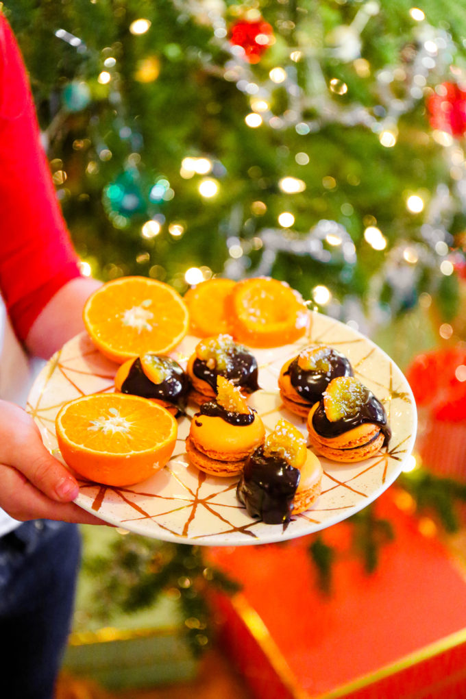 orange macarons with chocolate ganache and candied orange slices