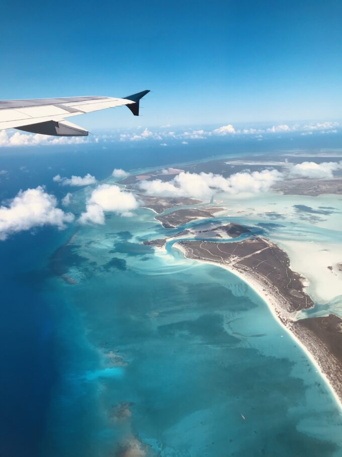 airplane view flying over tropical island