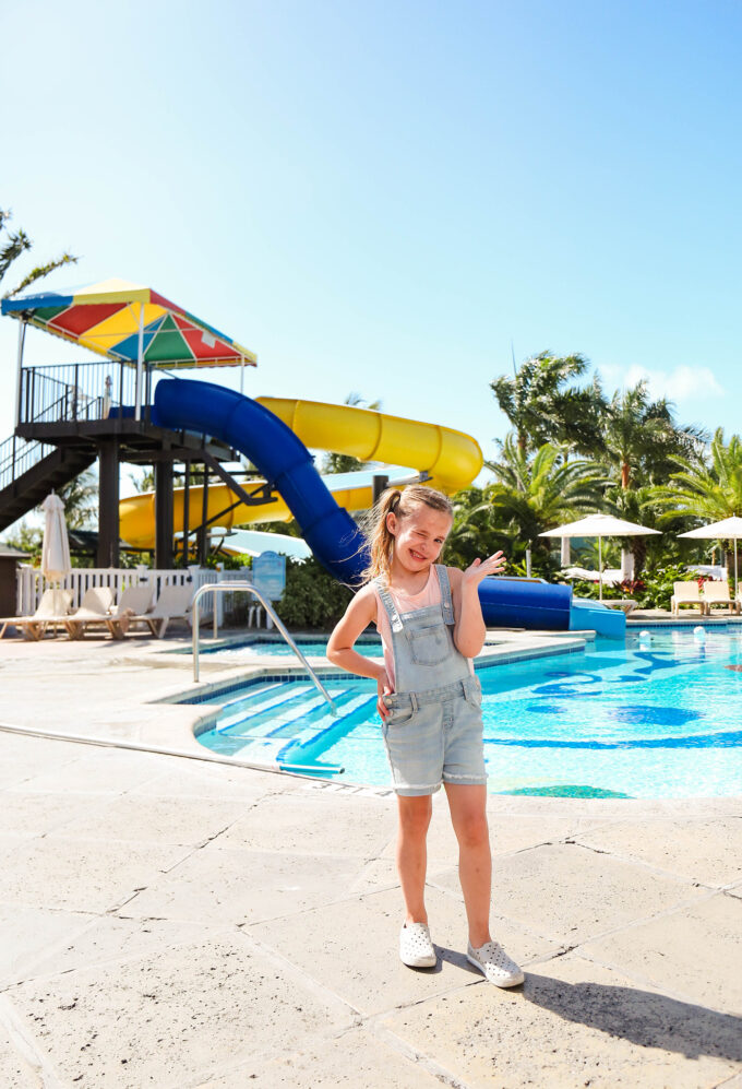 girl in front of waterslides