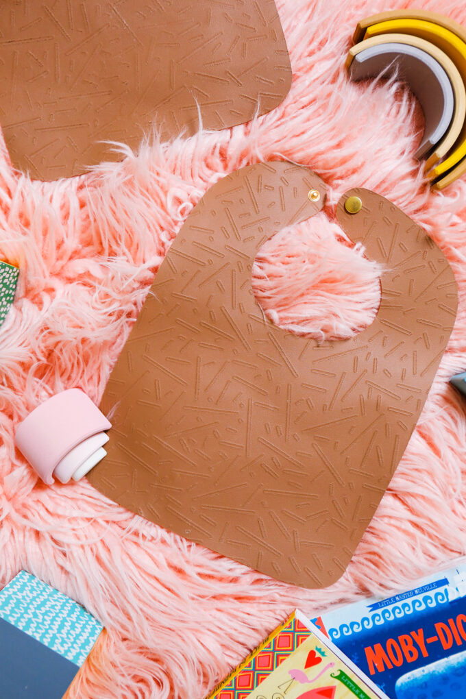 DIY leather bib flatly on pink background