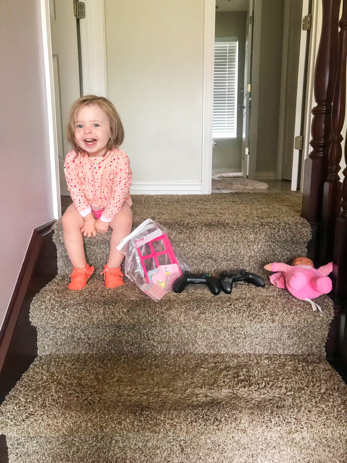 baby happy about toy organization