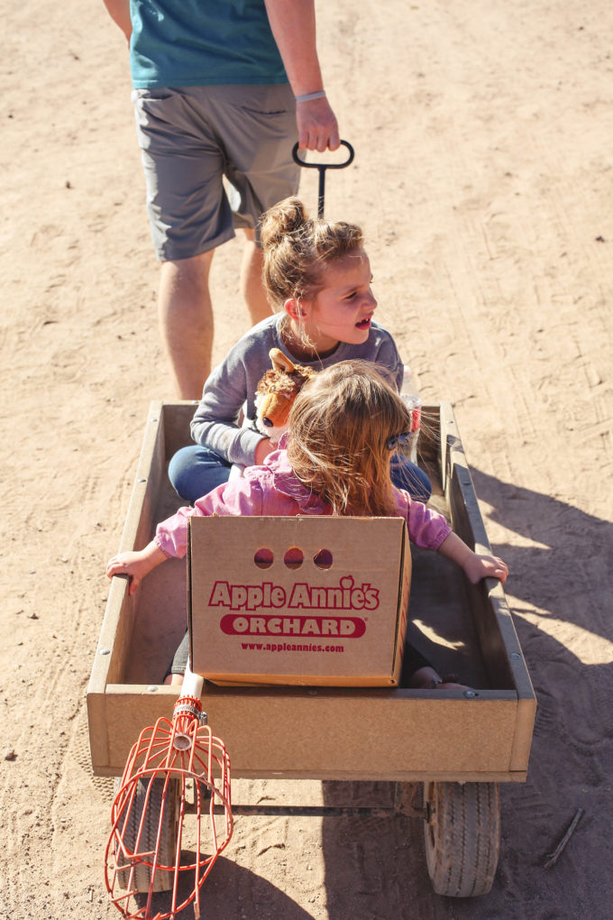 kids sitting in wagon