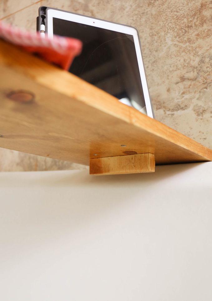 underneath shot of wooden bath tray